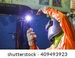 welder man tig welding in... | Shutterstock . vector #409493923