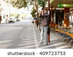male photographer taking picture | Shutterstock . vector #409723753
