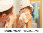 woman cleaning washing her face ... | Shutterstock . vector #409853893