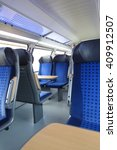 Small photo of HALLE (SAALE), GERMANY - CIRCA MARCH 2013 - blue train seats empty useful as travel concept