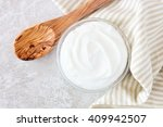 greek yogurt in a bowl ... | Shutterstock . vector #409942507