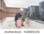 technician looking at a panel... | Shutterstock . vector #410003143