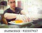male cooks preparing sushi in... | Shutterstock . vector #410107417