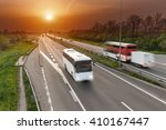 two buses driving in motion... | Shutterstock . vector #410167447