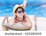 beautiful young woman relaxing... | Shutterstock . vector #410184343