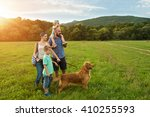 Stock photo beautiful young family with their pet dog golden retriever 410255593