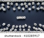 word risk of small white cubes... | Shutterstock . vector #410285917