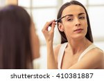 beautiful girl is doing a... | Shutterstock . vector #410381887