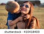 the son kisses and hugs his mom ... | Shutterstock . vector #410418403
