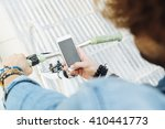 handsome young man with mobile... | Shutterstock . vector #410441773