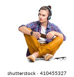 young fashion man sitting on... | Shutterstock . vector #410455327