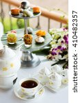 Small photo of Afternoon tea ceremony, beach restaurant with sea view, flowers orchids, sweets, deserts, fruits
