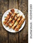 chicken kebabs on wooden...   Shutterstock . vector #410545183