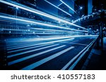 car trails on the high street... | Shutterstock . vector #410557183