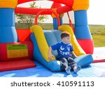 young boy playing on a colorful ... | Shutterstock . vector #410591113