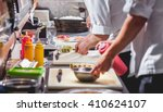 male cooks preparing sushi in... | Shutterstock . vector #410624107