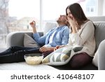Young Couple Watching Tv On A...