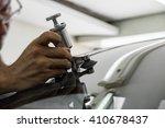 mechanic using repairing... | Shutterstock . vector #410678437