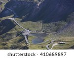 Small photo of Two small lakes in a valley girded by a winded mountain road and surrounded by the mountains in a spring sunny day. The Grossglockner, the High Tauern National Park. View form above