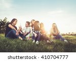 group of young people having... | Shutterstock . vector #410704777
