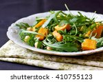 salad with arugula  pumpkin and ... | Shutterstock . vector #410755123