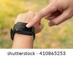 hands of woman looking... | Shutterstock . vector #410865253