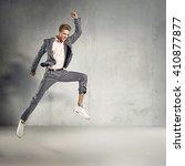 trendy elegant guy jumping in...   Shutterstock . vector #410877877