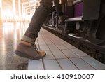 traveler feet step up to a... | Shutterstock . vector #410910007