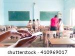girl use mobile phone  blur...   Shutterstock . vector #410969017