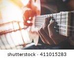Boys Hand With A Guitar.