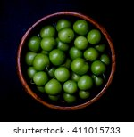 Wooden Bowl Of Green Plums....