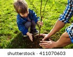 little boy helping his father... | Shutterstock . vector #411070603
