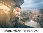 a young pilot in sightseeing... | Shutterstock . vector #411078997