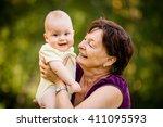 grandmother with grandchild  ... | Shutterstock . vector #411095593