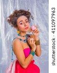 beautiful girl in bright... | Shutterstock . vector #411097963