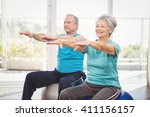 happy senior couple performing... | Shutterstock . vector #411156157