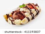 Stock photo banana split sundae ice cream in a bowl with strawberry and raspberry vanilla icecream scoops 411193837