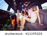 frivolous women in a limousine... | Shutterstock . vector #411195103