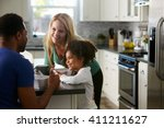 mixed race couple and daughter...   Shutterstock . vector #411211627