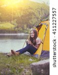 girl hiker in a tent and... | Shutterstock . vector #411227557