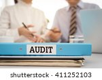 Small photo of The audit file of financial statements with the auditor are providing advice to manager. Accounting auditing concept.