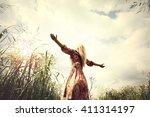 young woman enjoying nature in... | Shutterstock . vector #411314197
