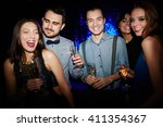 dancing with champagne | Shutterstock . vector #411354367