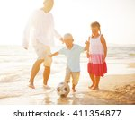 family playing on the beach. | Shutterstock . vector #411354877