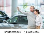 young couple making selfie at...   Shutterstock . vector #411369253