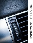 """Small photo of The word """"Airbag"""" is written on a car's dashboard."""