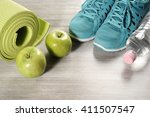 yoga mat with sport shoes and... | Shutterstock . vector #411507547