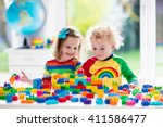 child playing with colorful... | Shutterstock . vector #411586477