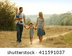 a young family on the nature | Shutterstock . vector #411591037