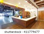 wood reception desk in modern... | Shutterstock . vector #411779677